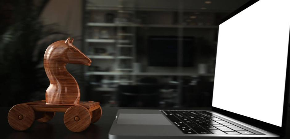 wooden horse next to laptop